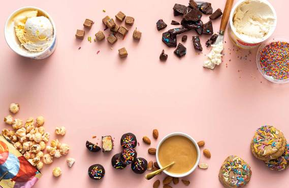 Various cake-flavored foods shot from above on a pink background