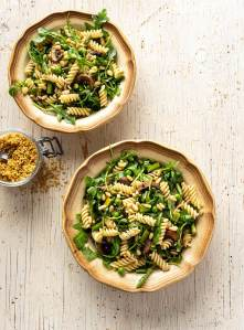 Two vintage bowls filled with pasta and greens